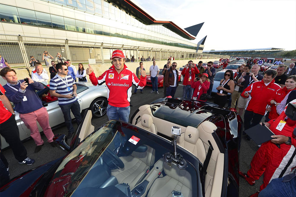 Ferrari record parade G2 Felipe Massa and Marc Gene lead a record breaking parade of Ferraris at Silverstone   w/VIDEO