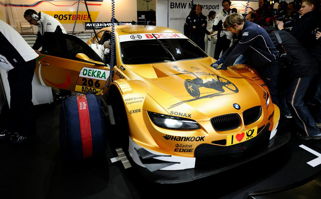 Paralympic champion Alex Zanardi drives a golden BMW M3 DTM at the 40th anniversary of BMW M event